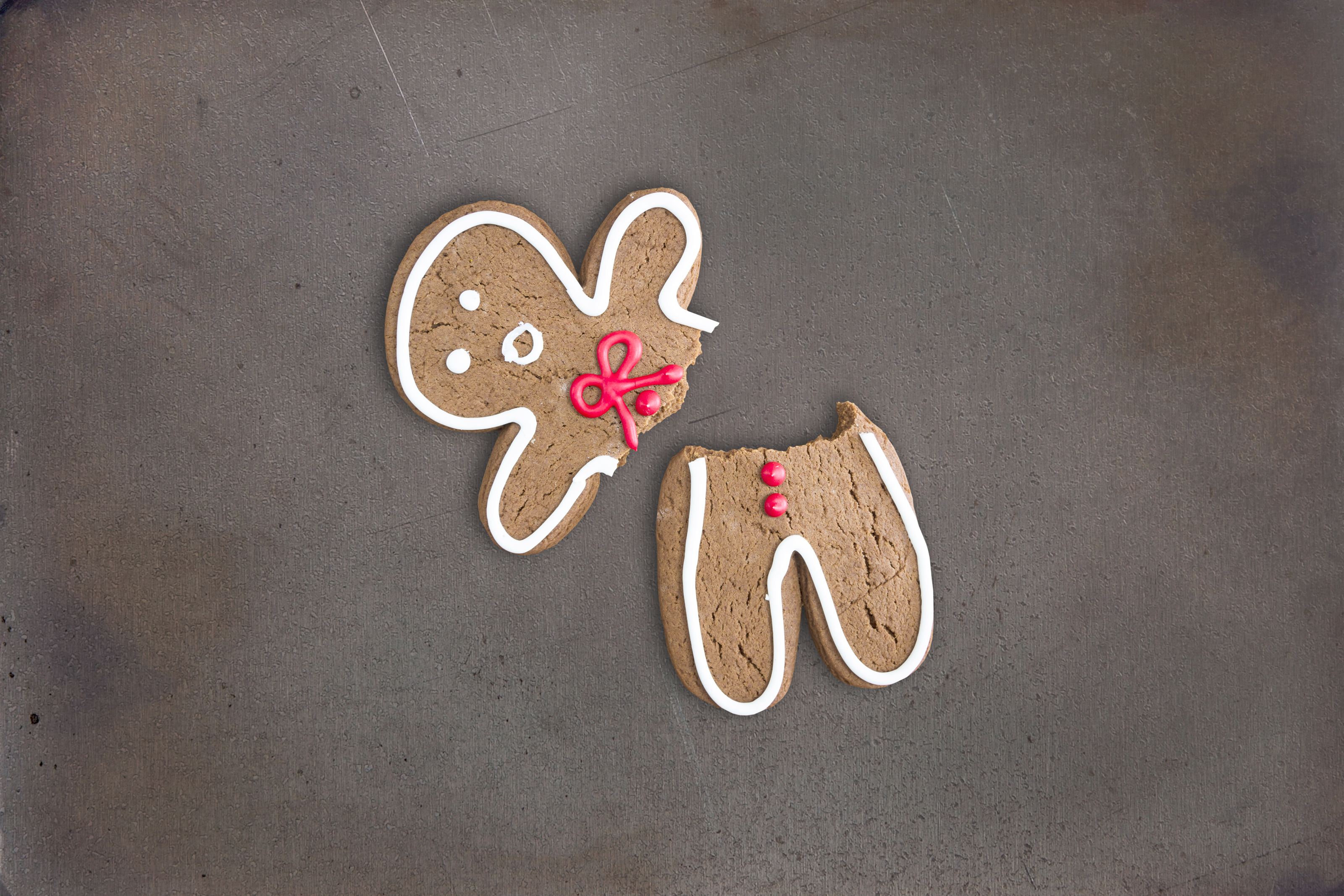 Broken gingerbread cookie on baking tray