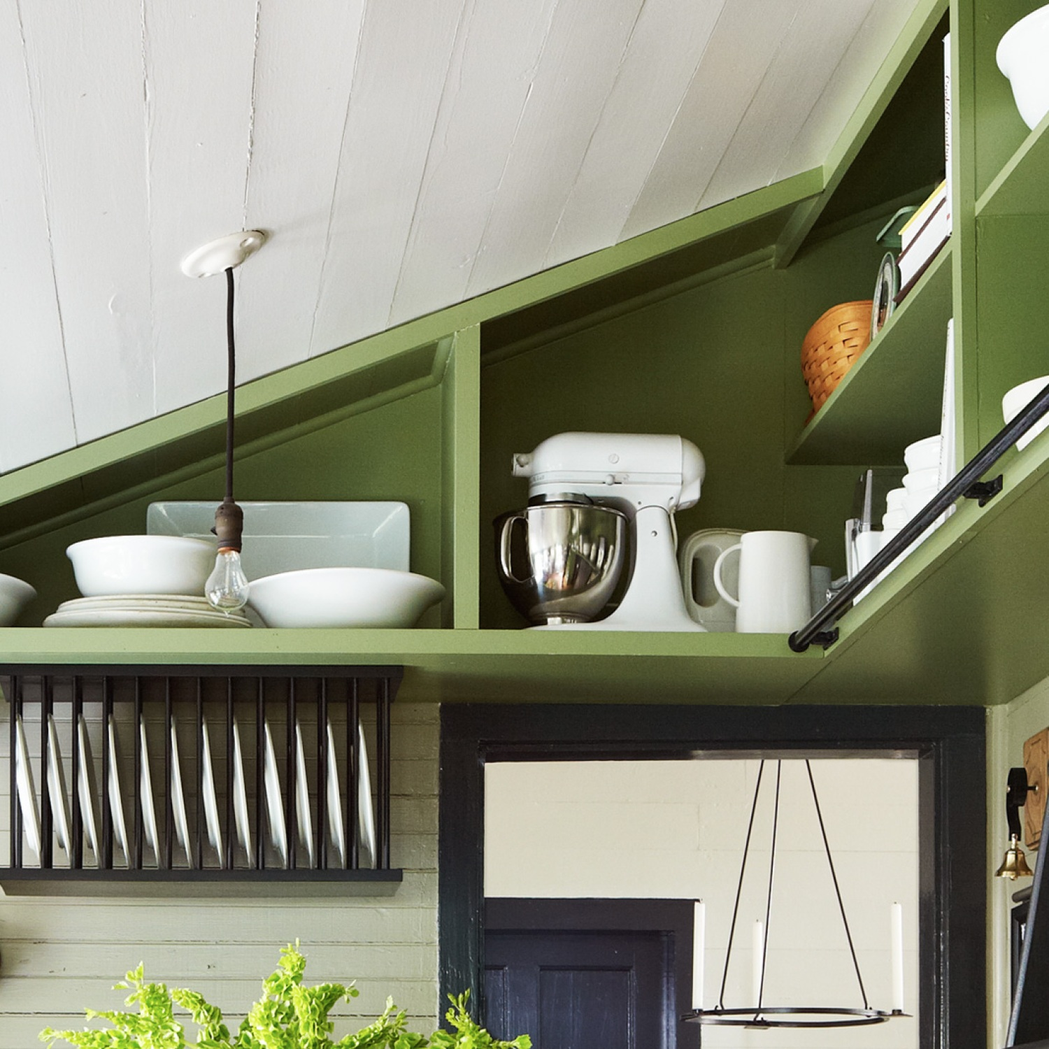 Kitchen with built-in rafter shelving