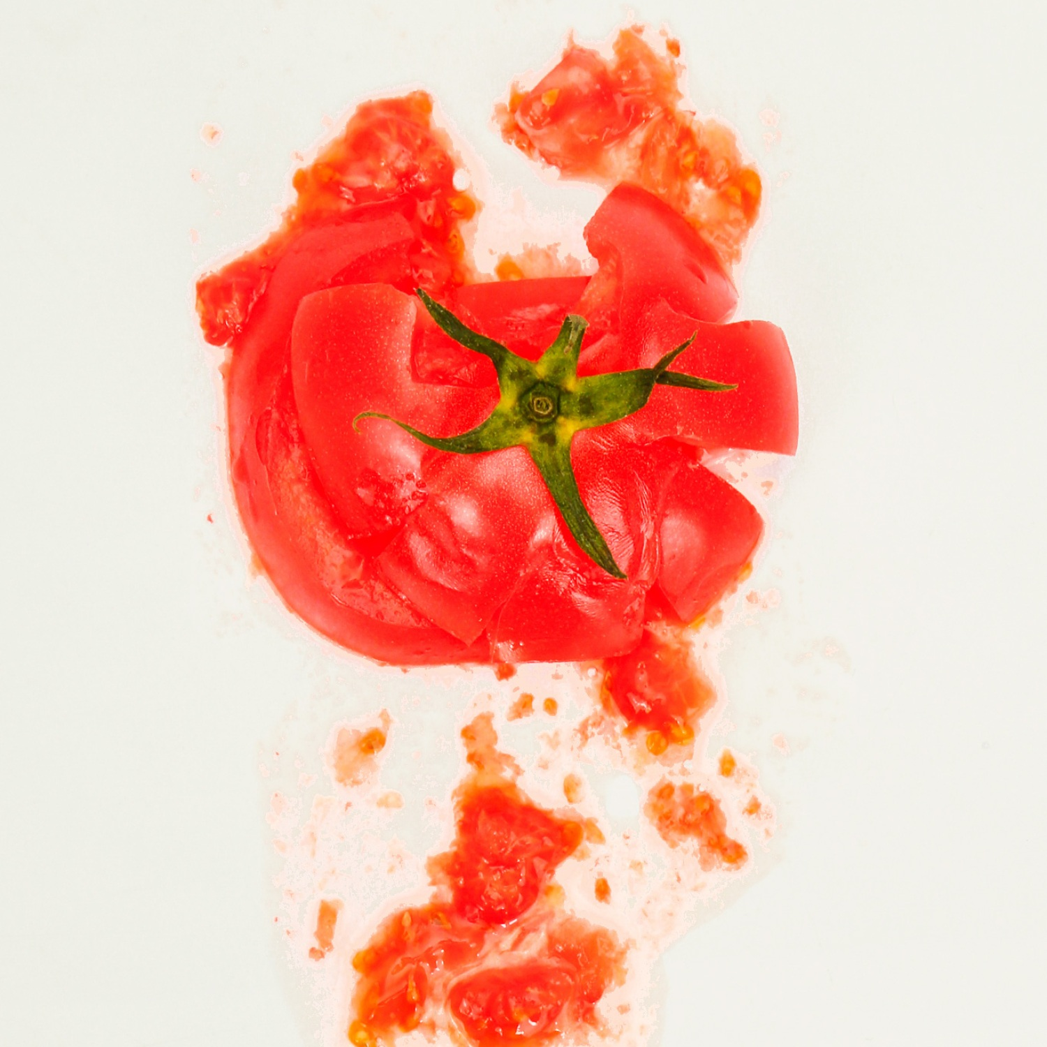 Tomato splatted against a kitchen wall