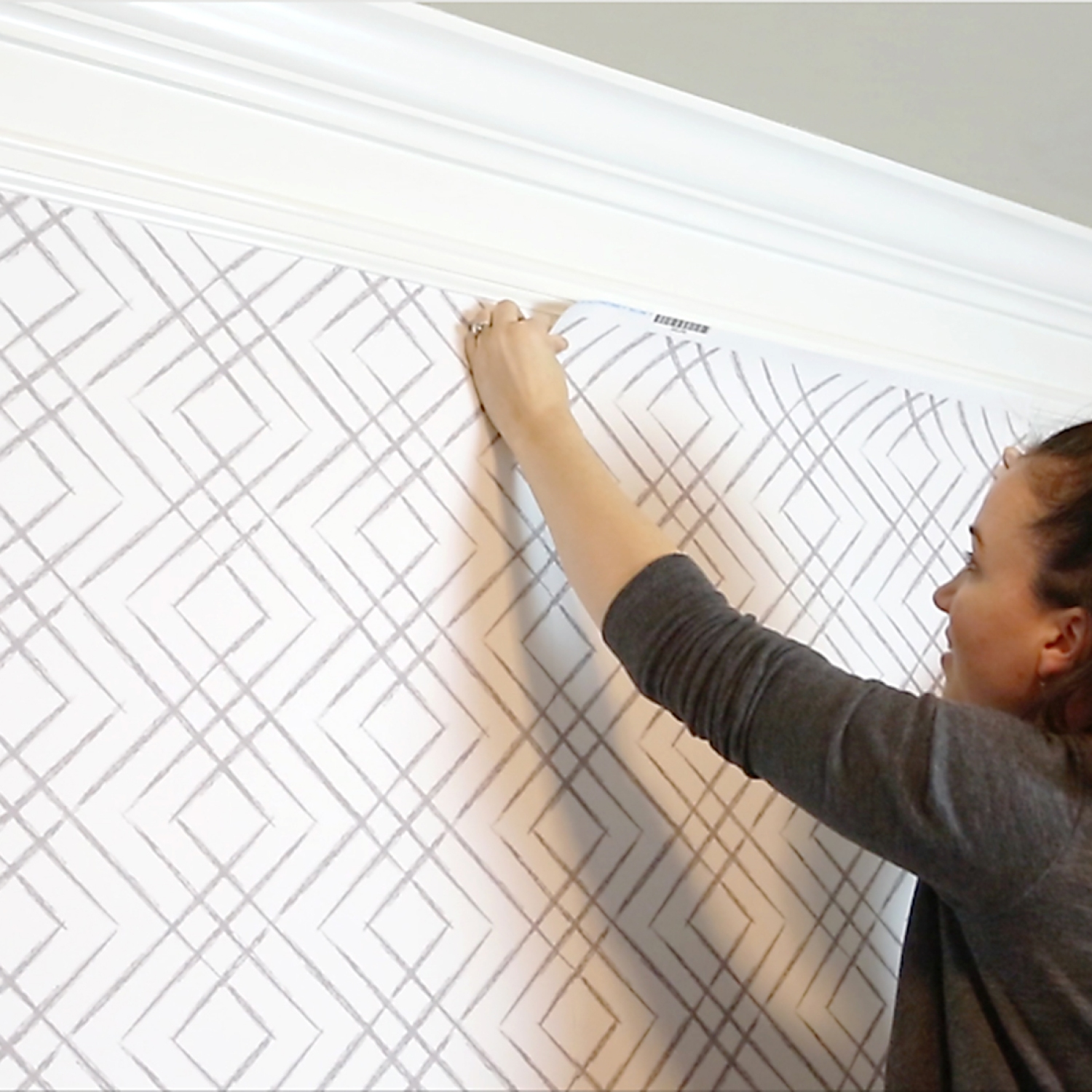 Katie Bower installs peel-and-stick wallpaper