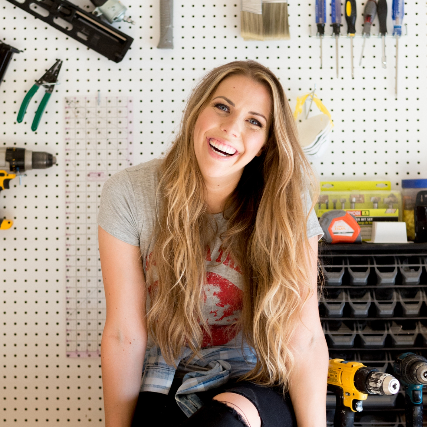 Mandi Gubler sitting on a work bench