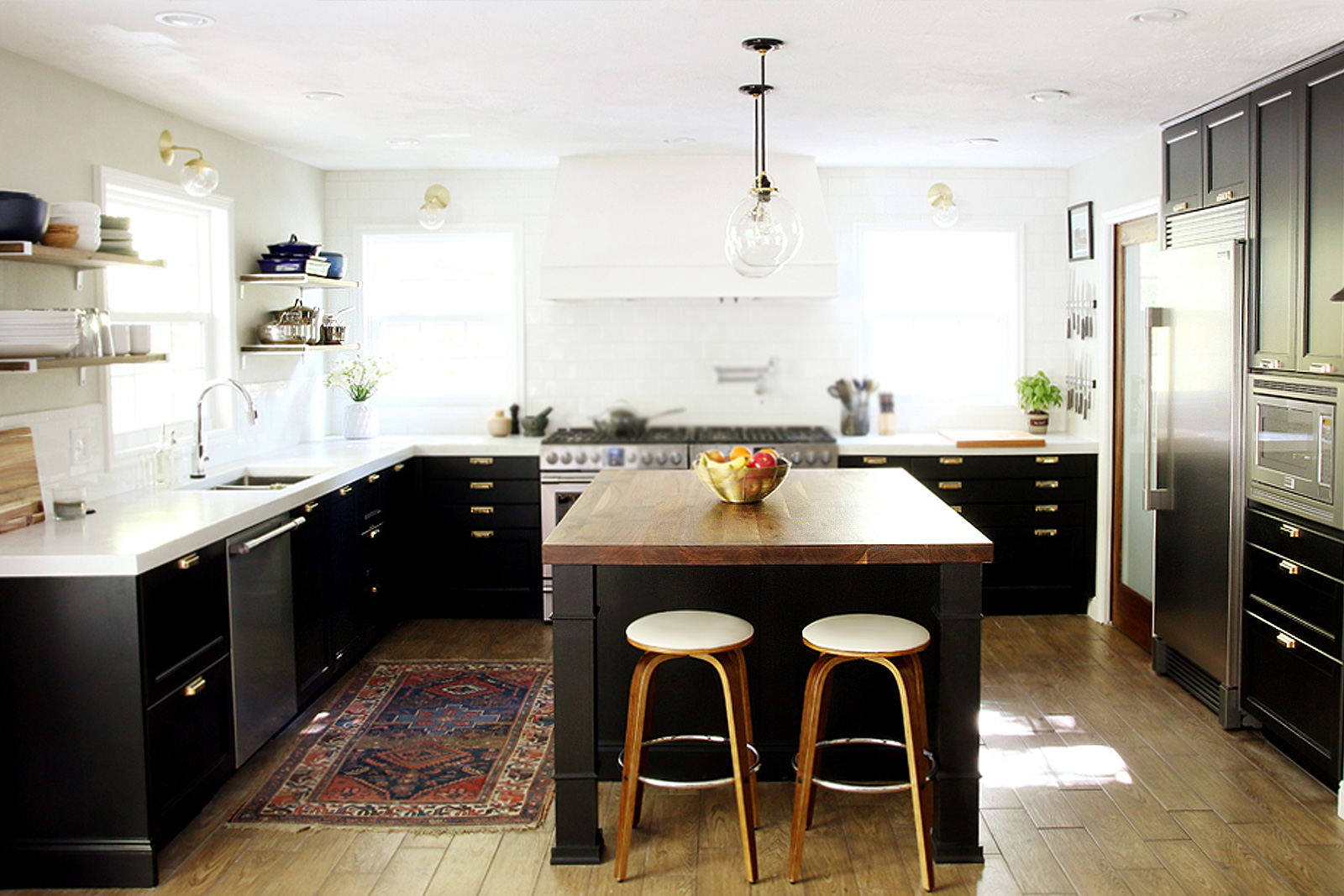 Updated kitchen with black cabinets, white countertops