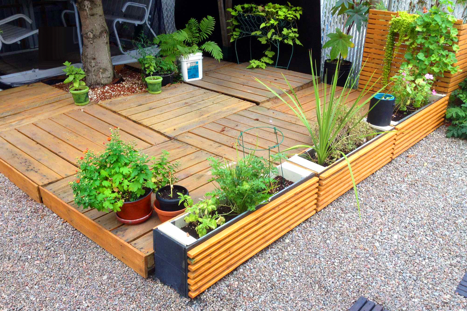 DIY pallet deck outside a home