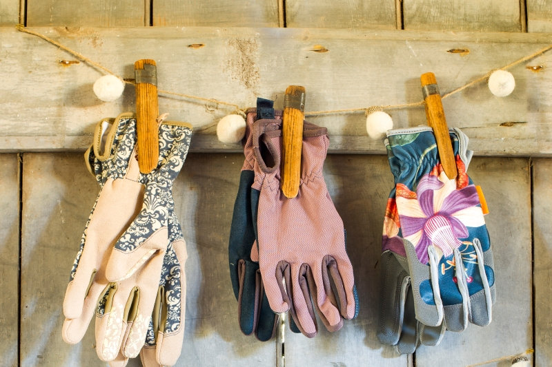 Garden gloves stored on line with clothespins