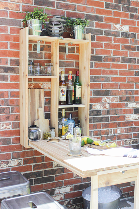 Open wood murphy bar on a brick wall with gray stools