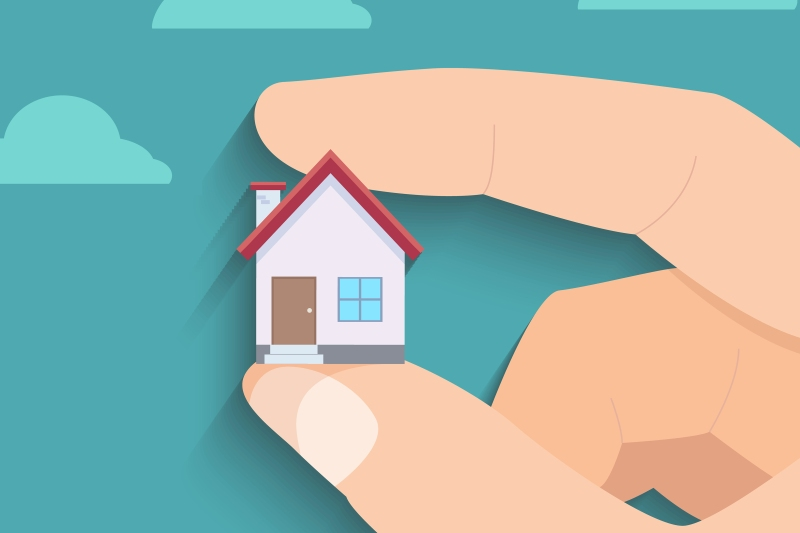 Illustration of holding a home in between two fingers