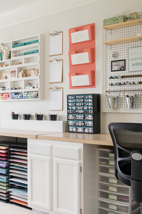 Tidy bright craft room with pegboard organization