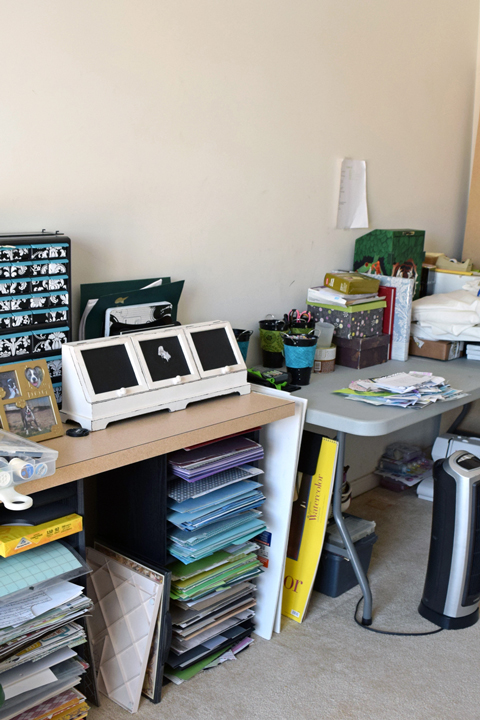 Messy craft room with plastic table, bookshelf, chair