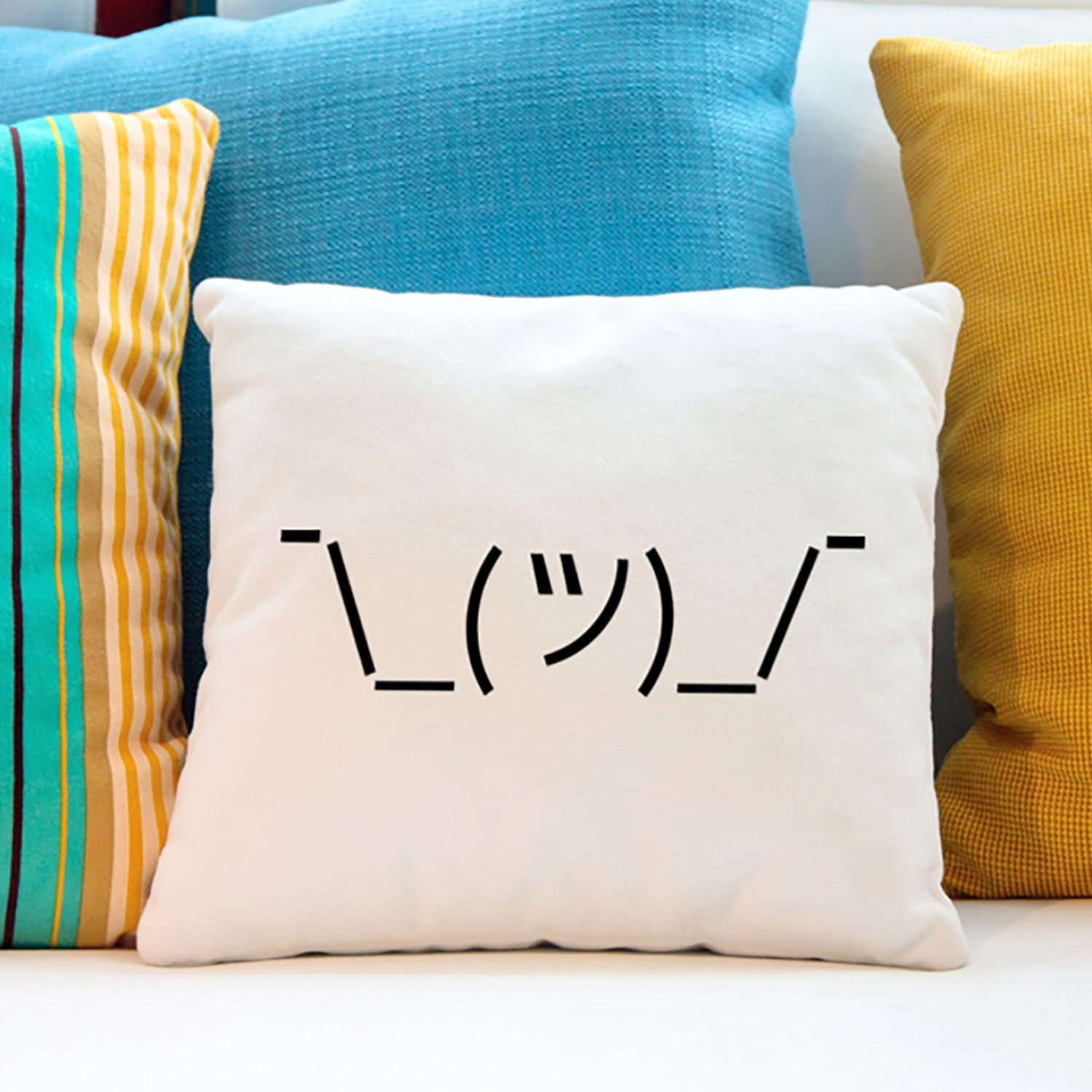 Shrugging emoji on a throw pillow
