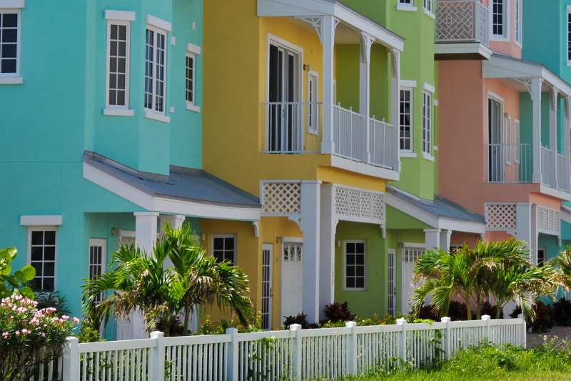 Colorfully painted condo exteriors in a warm climate