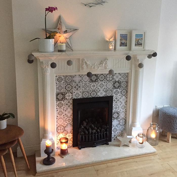 A fireplace with tile stickers