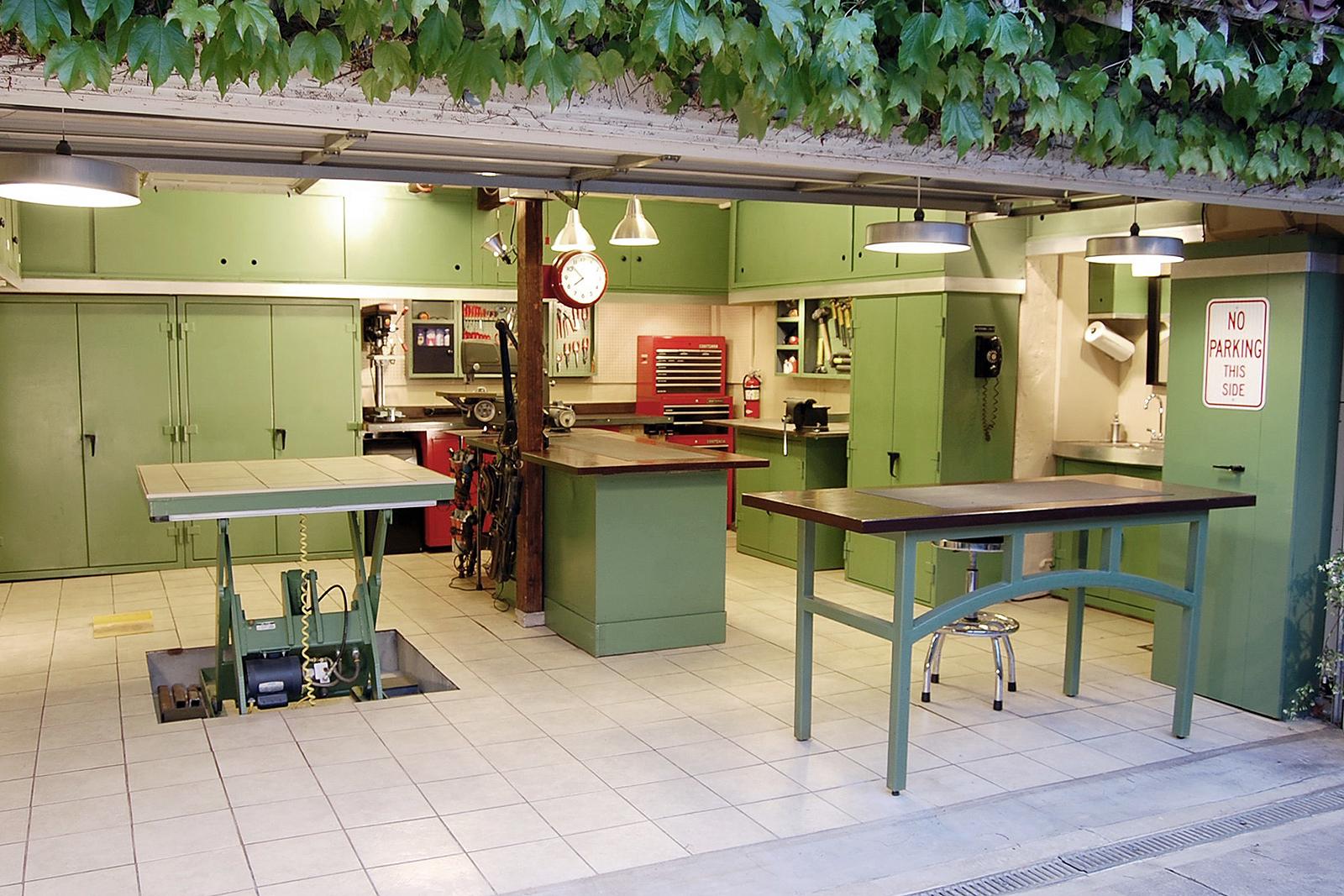 Open garage door with green cabinetry