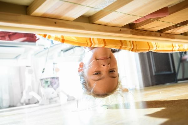 Looking underneath the bed for dust bunnies