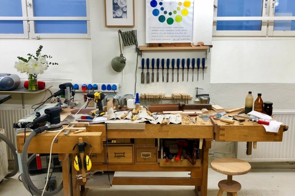 A messy wood work bench in a basement