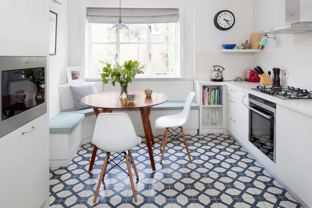 A white contemporary kitchen with blue and white glazed tile