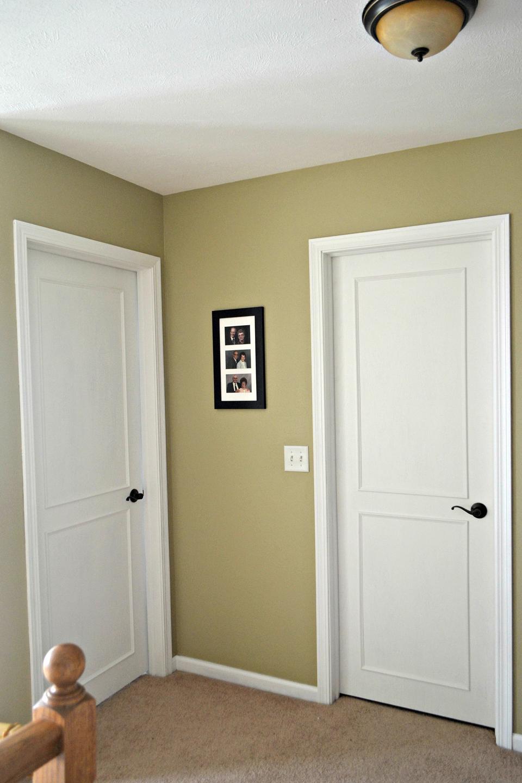 A white DIY paneled door