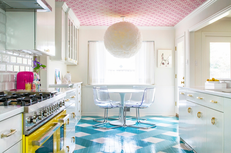 Colorful kitchen with bright wallpapered ceilling