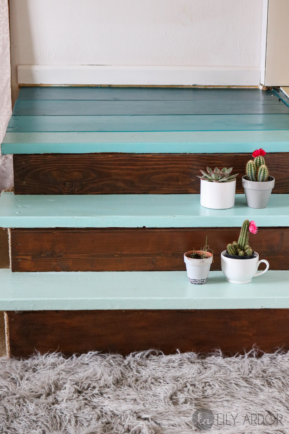 A blue ombre-painted small staircase