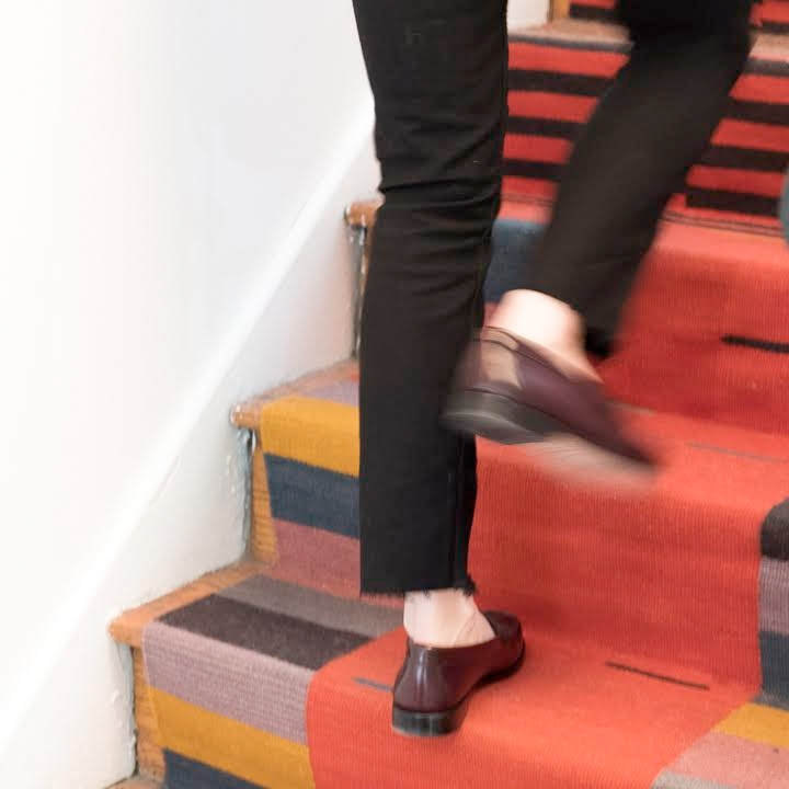Woman walking up stairs with her custom runner