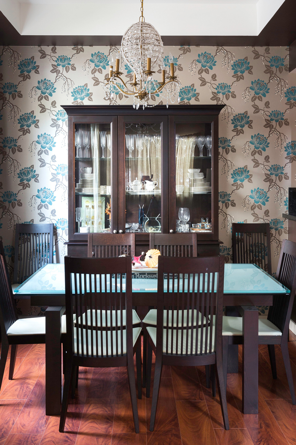Blue and gray brown floral wallpaper in a dining room