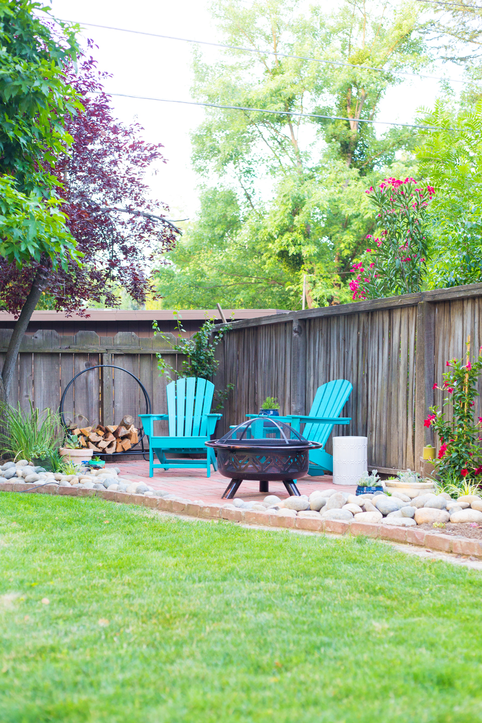 An after image of a backyard patio with firepit