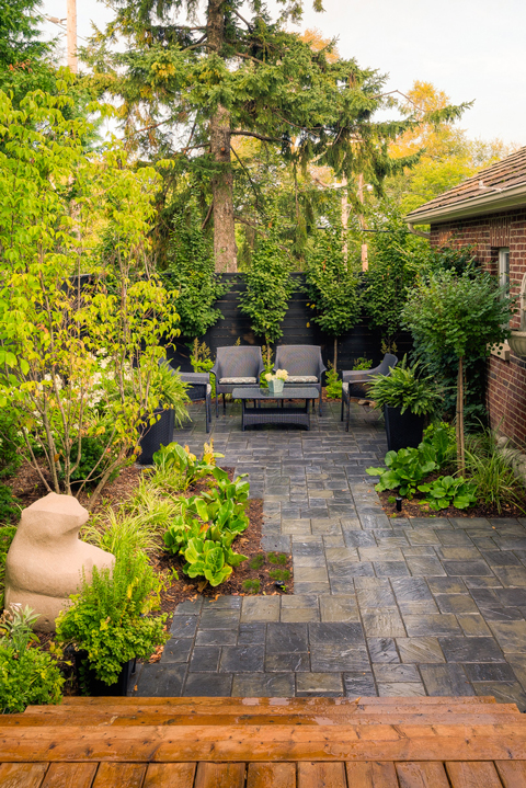 An after image from a deck with lush green grass