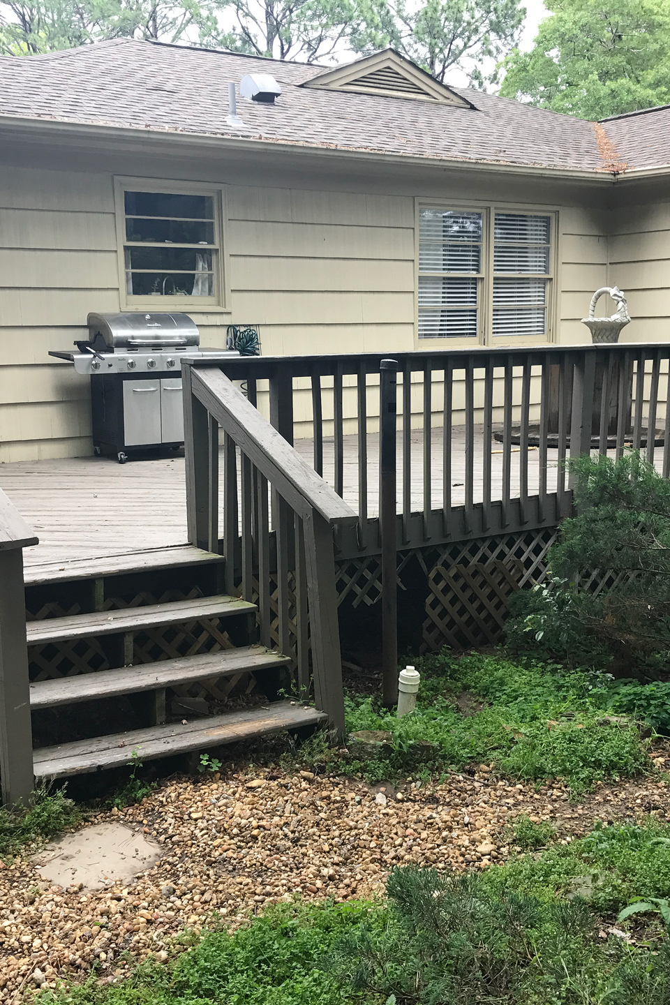 A before image of an old deck in a backyard