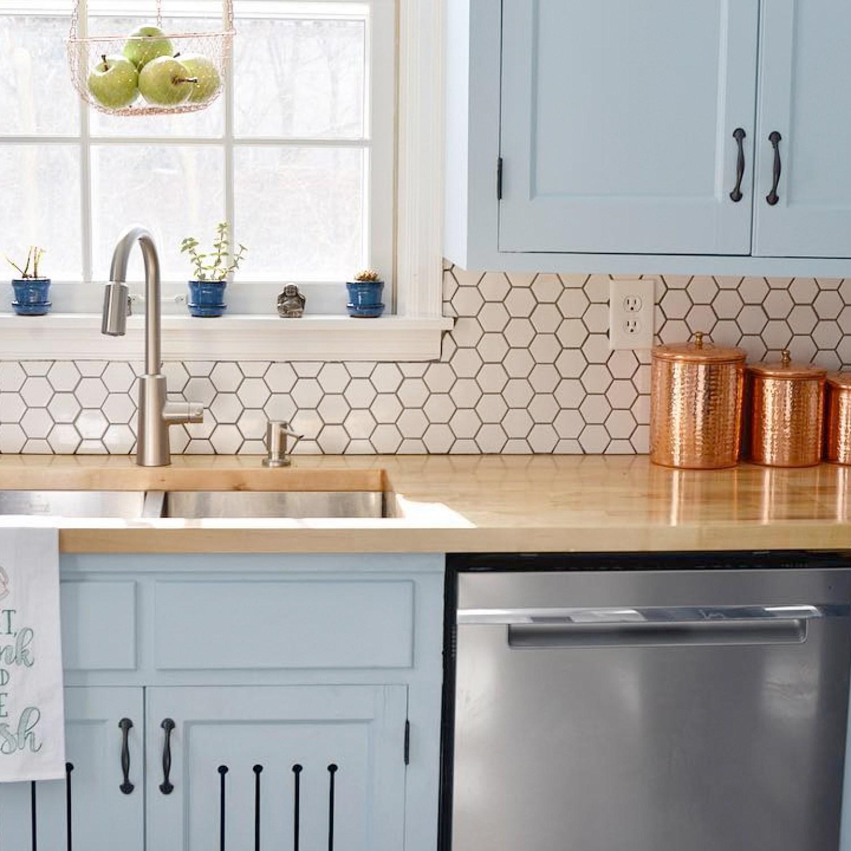 Newly renovated kitchen with hex tile backsplash