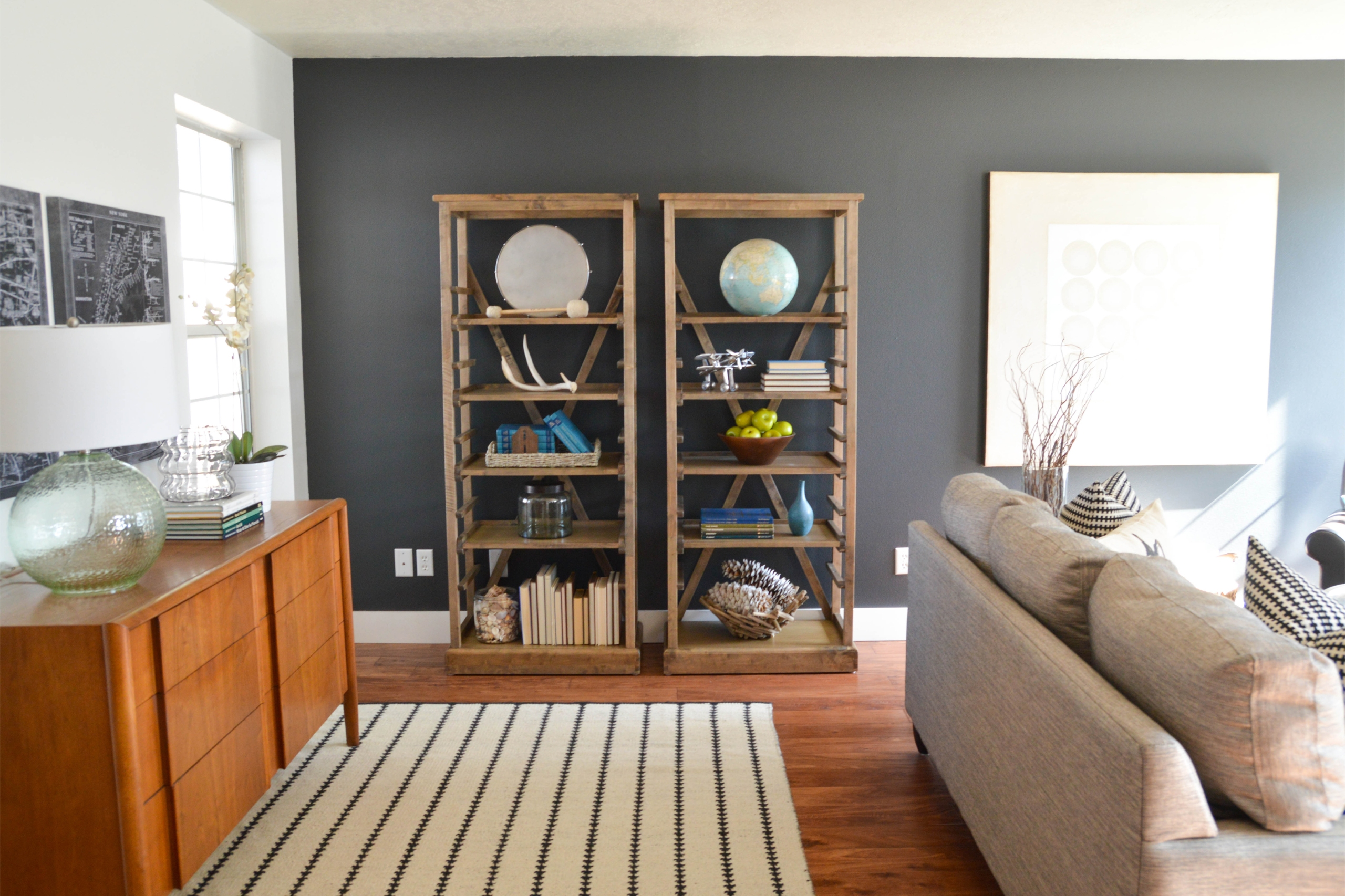 Charcoal paint on an accent wall in a home living room