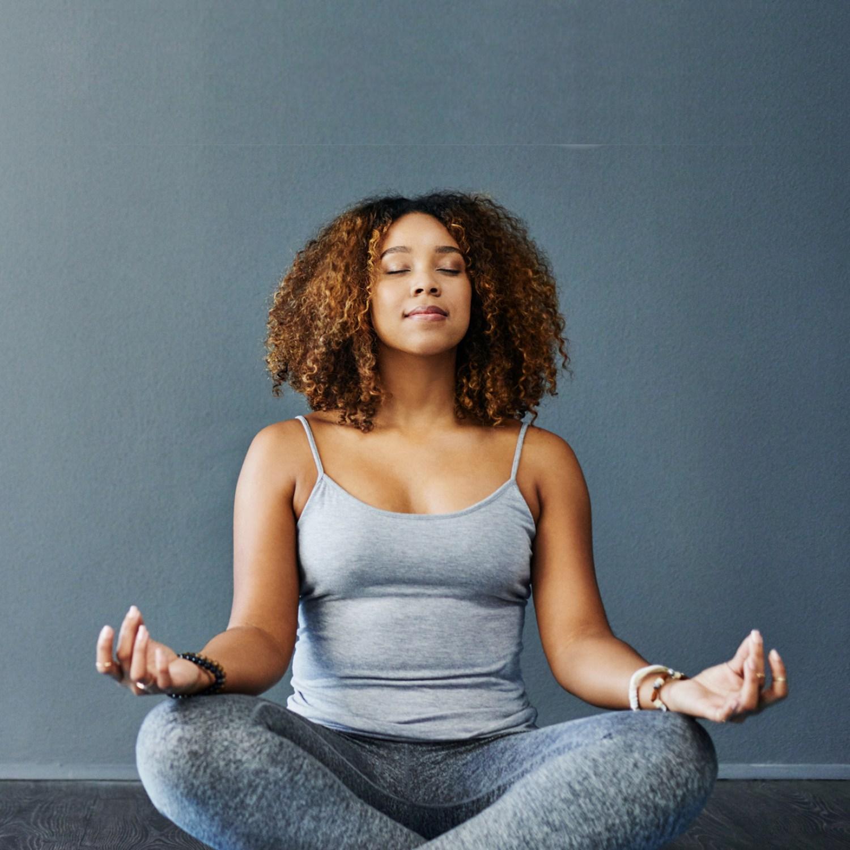 Woman at home doing yoga pose