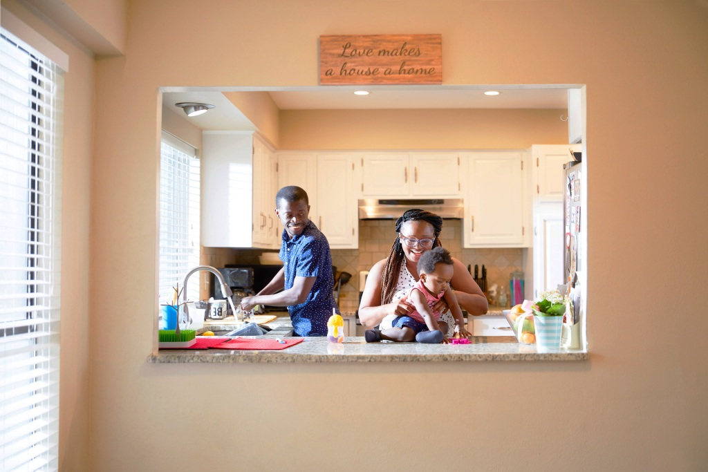 Anthony Tucker and Sammy Kallay with their son in kitchen