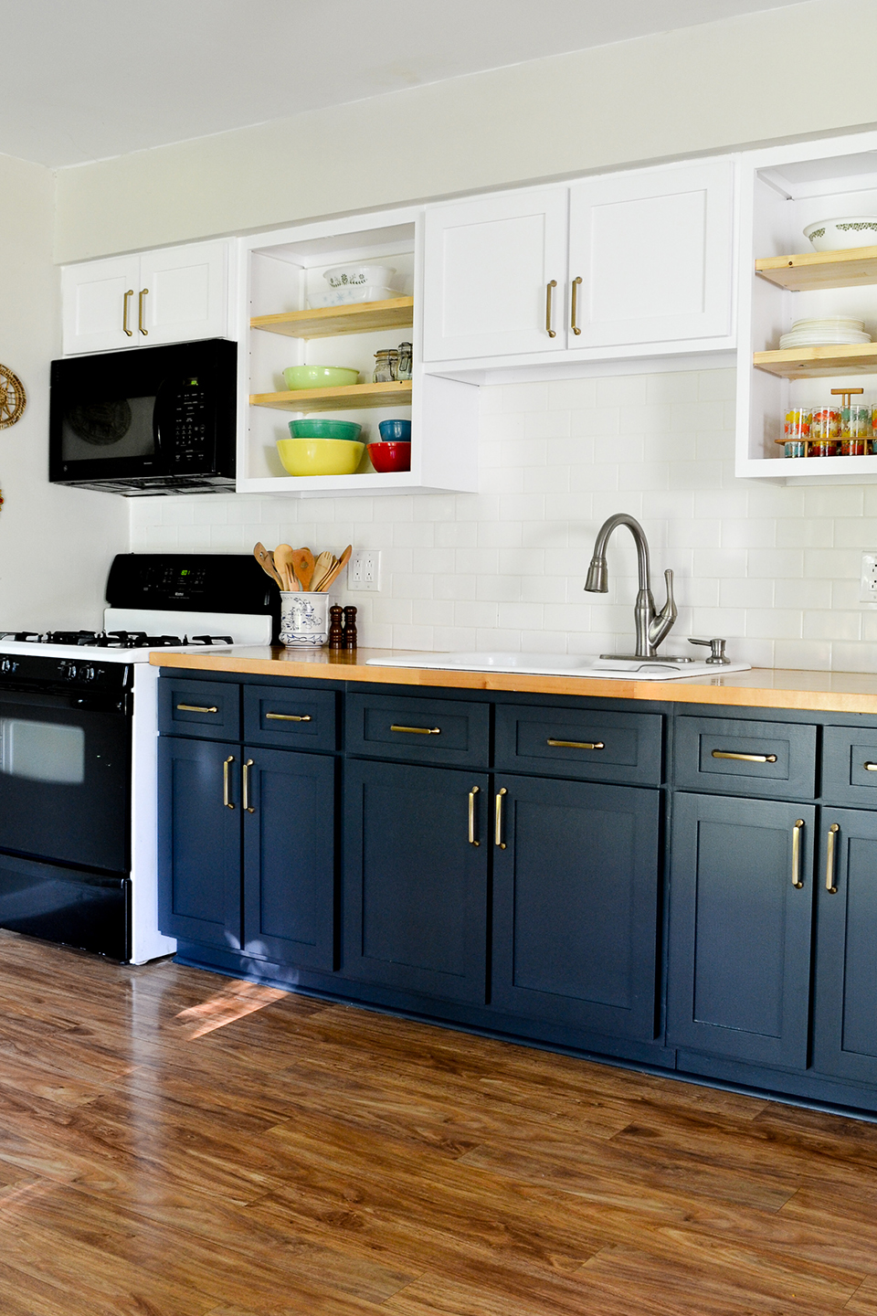 Blue and white cabinet doors in kitchen with open shelves
