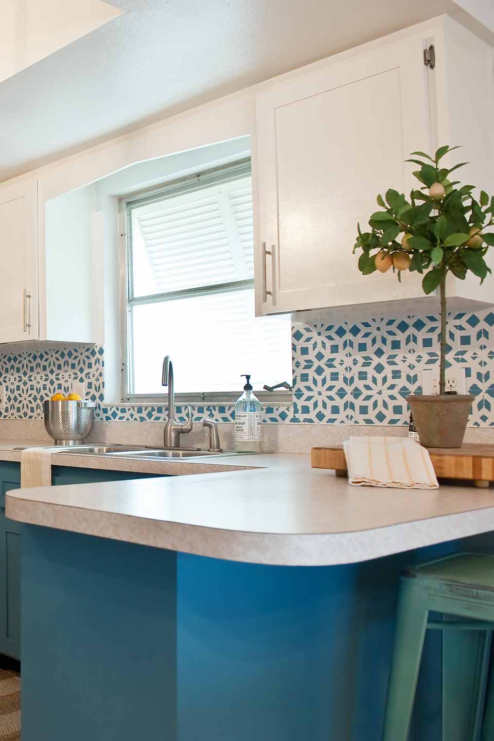 Blue and white kitchen with starburst stenciled tile
