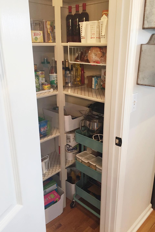 Blue baking cart tucked inside a closet   Organized Holiday