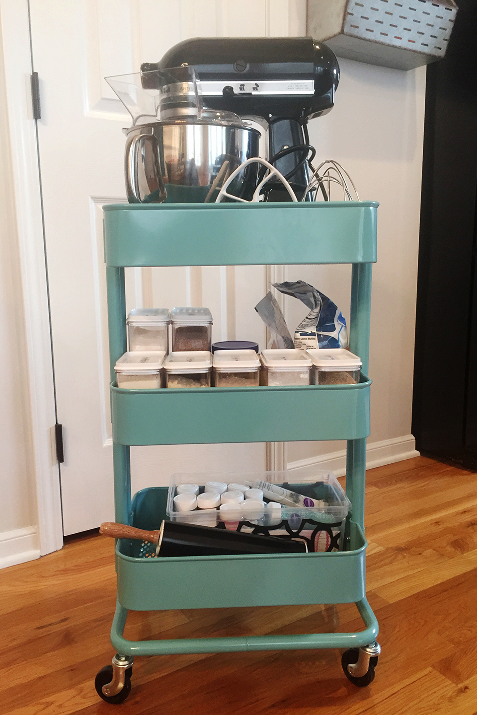 Blue rolling cart with stand mixer and other baking items