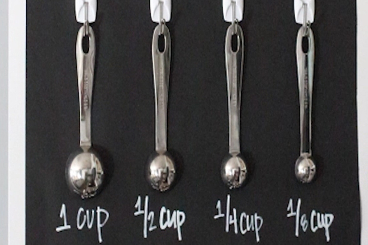 Split screen of Sahar and cupboard wall of spoons
