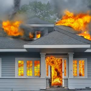 Fire engulfing a home