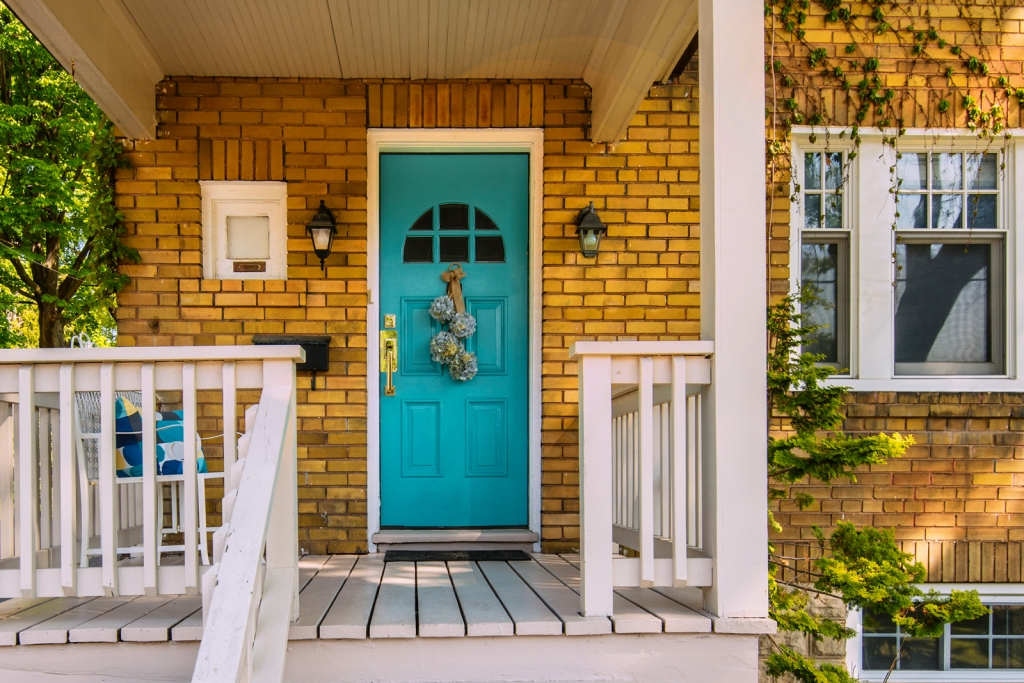 Home with small front porch in urban setting