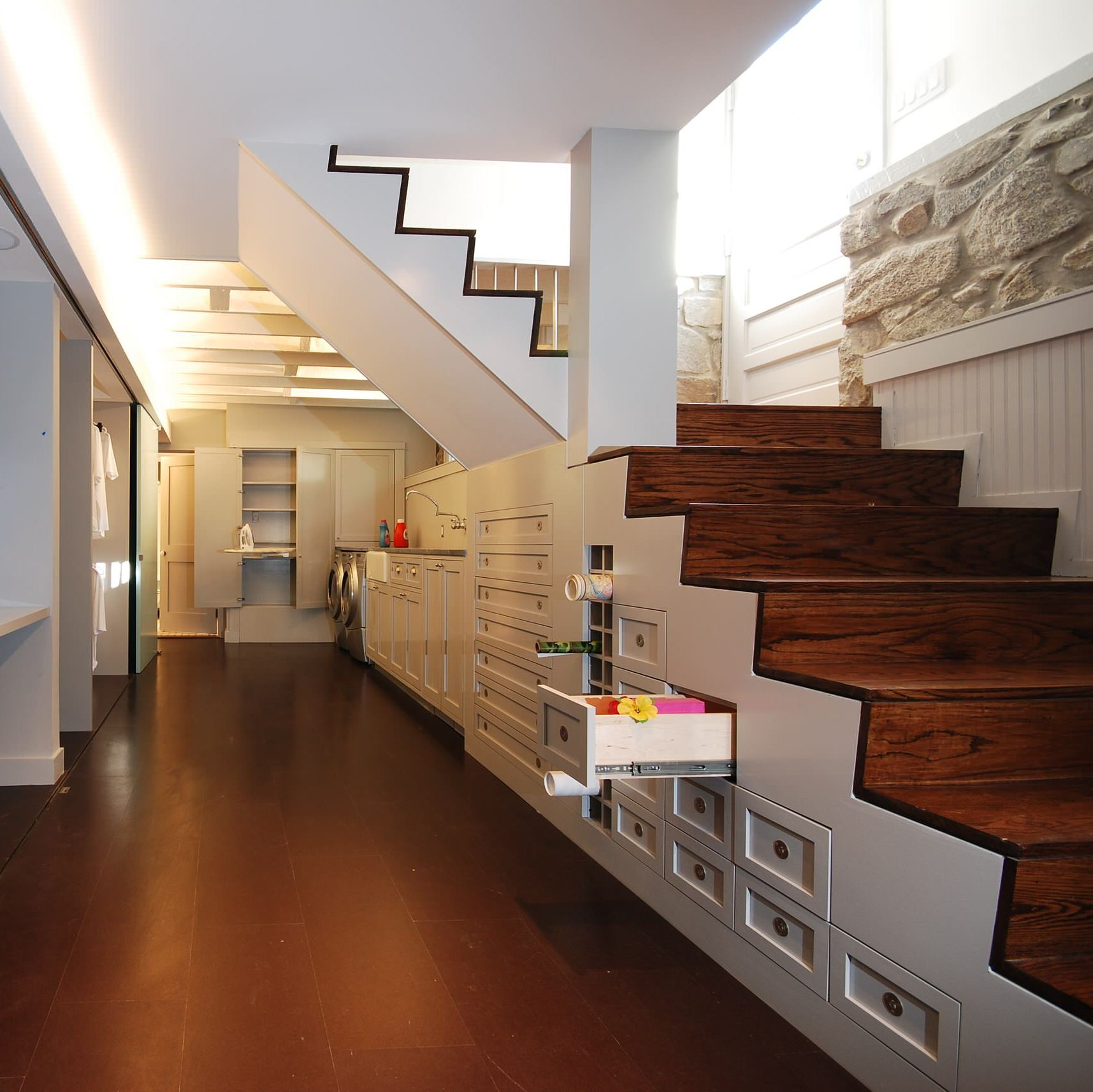 Custom basement under-stairs storage drawers