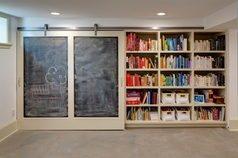 Built-in basement bookshelves for storage