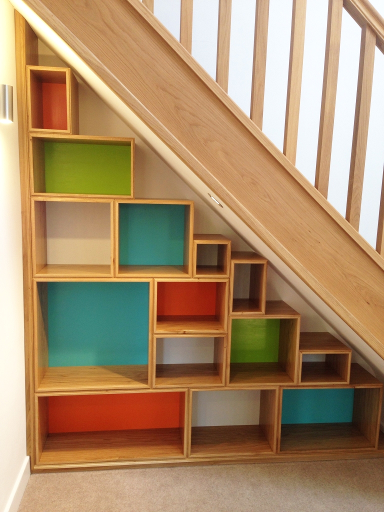 Colorful storage boxes under stairs