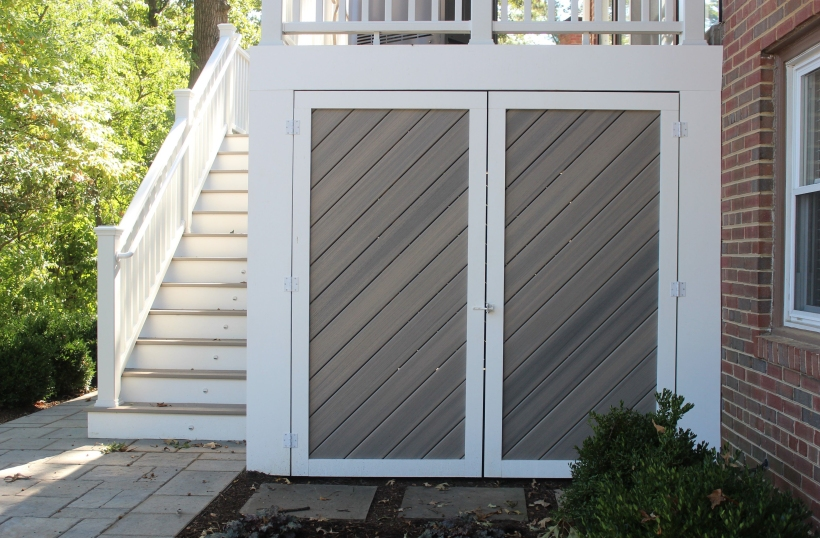Custom under deck storage shed with double doors