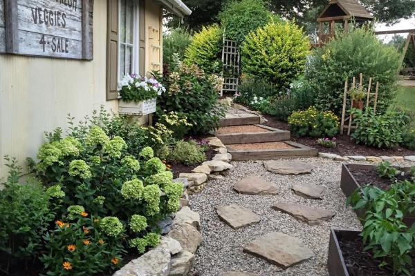 Stone and gravel front walkway to home