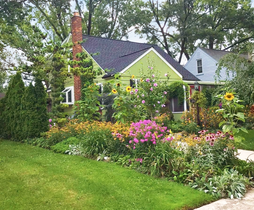 Front yard garden bed filled with perennial flowers