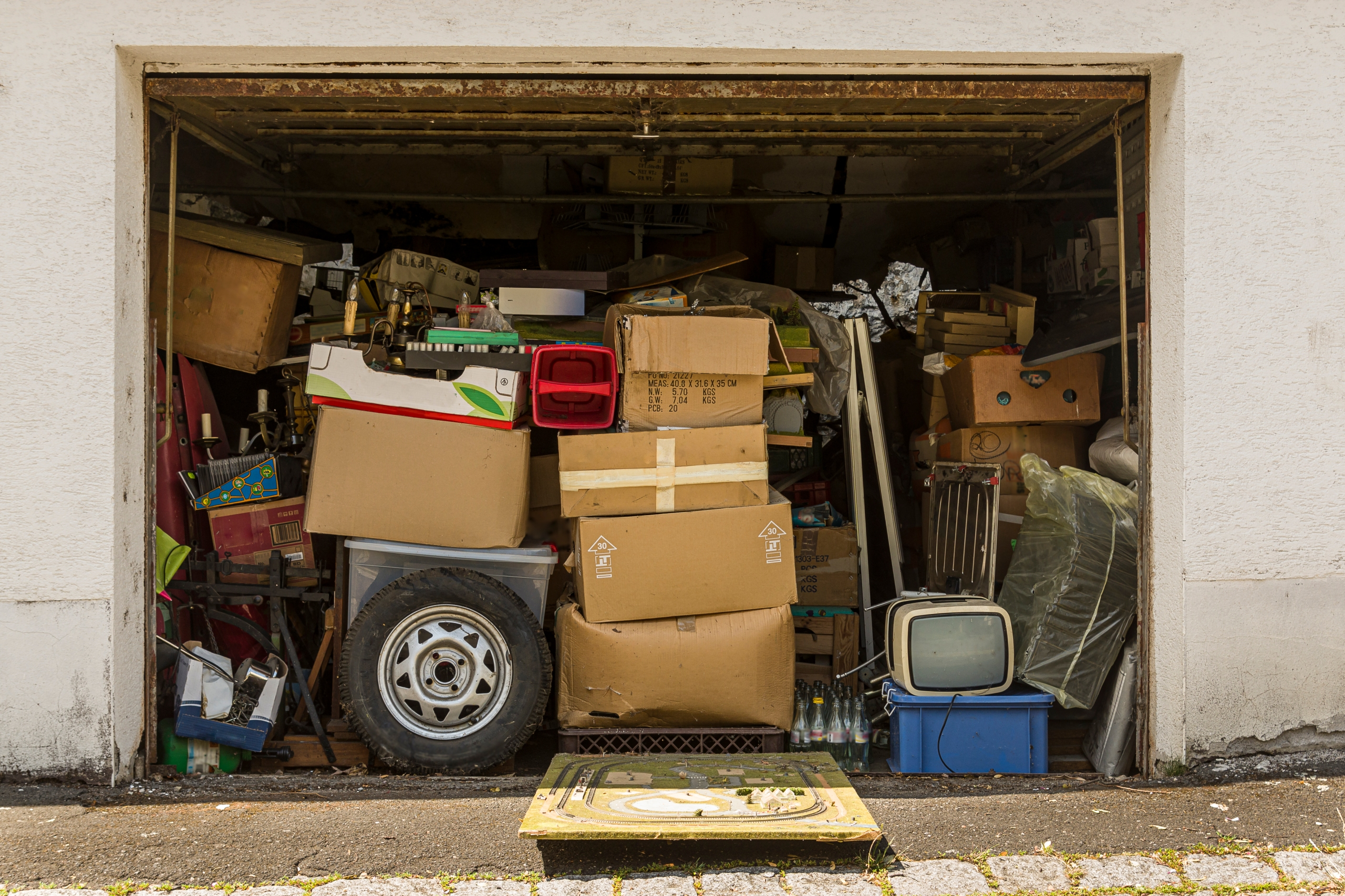 Open garage filled with boxes and old stuff