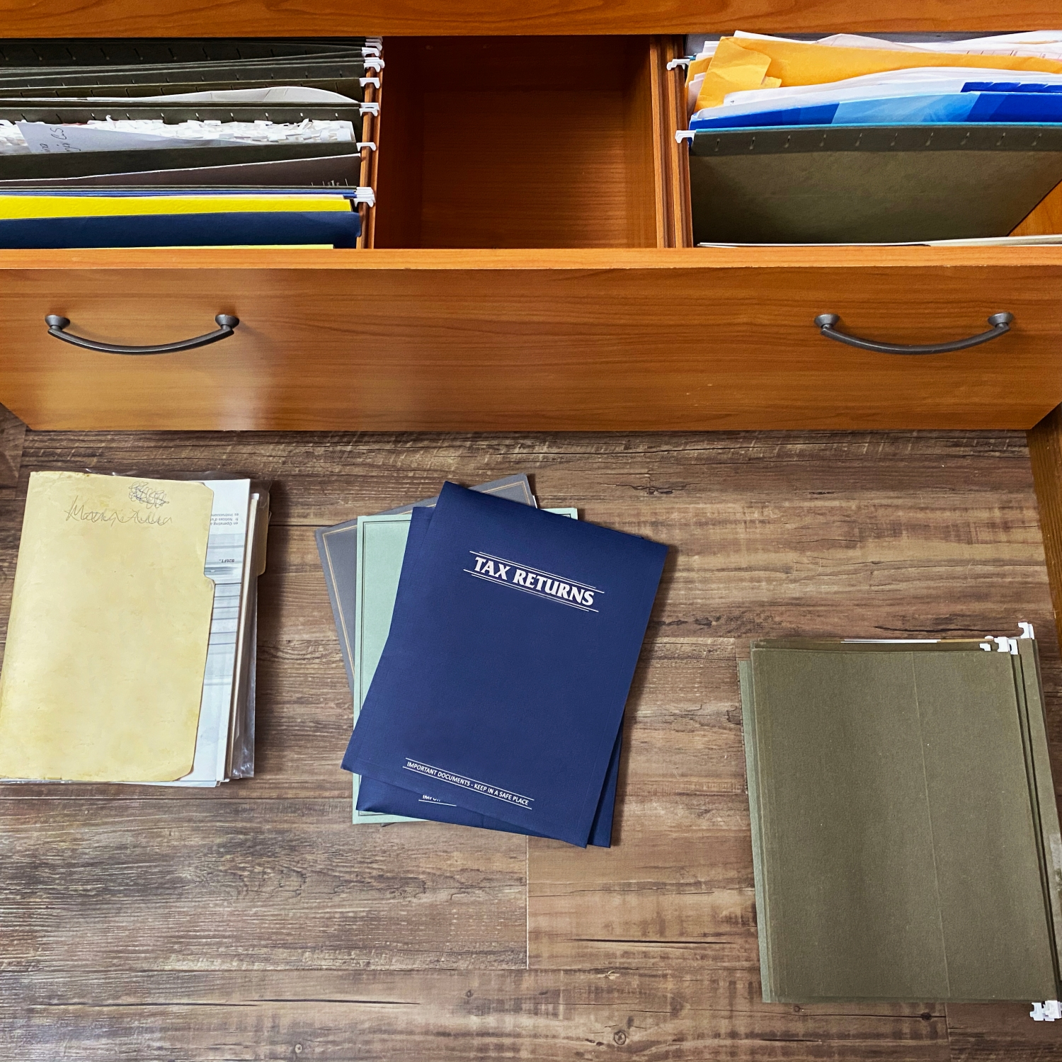 tax papers and files on floor and in file drawer